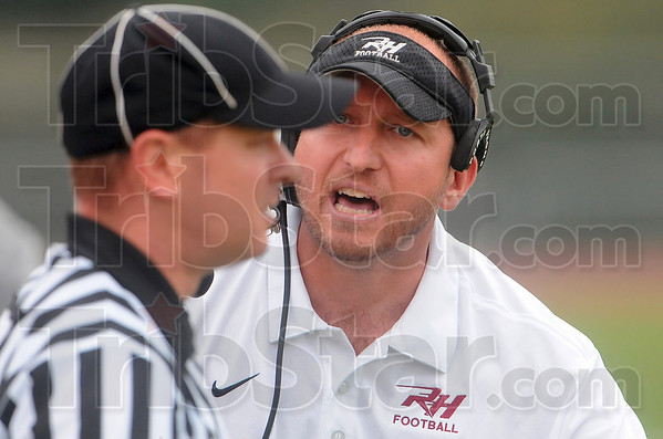 Tribune-Star/Joseph C. Garza<br /> You can't be serious: Rose-Hulman interim coach Jayson Martin lets his feelings be known to the official during the Engineers' game at DePauw Saturday.