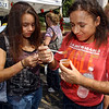 Taste testers: Sisters Micheal and Katie Tyler sample one of the batches of chili at the Altrusa Chili Cook-off Saturday.