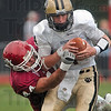 Tribune-Star/Joseph C. Garza<br /> DidnÕt get away: Rose-Hulman's Andrew Couch sacks DePauw quarterback Michael Engle during the Engineers' game against the Tigers Saturday in Greencastle.