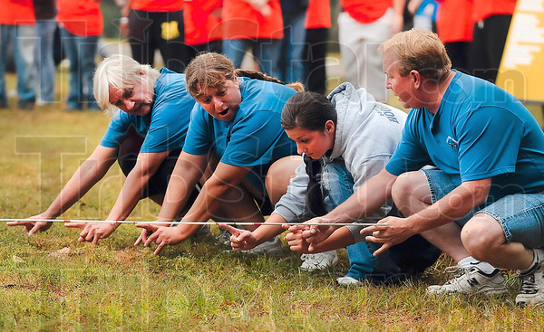 "Tribune-Star/Joseph C. Garza<br /> Hoosier Energy employees Paula Hobbs, Romane Lindley, Laura Lindley and Jeff Lookebill work together as they participate in the ""dip stick"" competition Saturday at Forest Park during the Corporate Olympics."