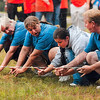 """Tribune-Star/Joseph C. Garza<br /> Hoosier Energy employees Paula Hobbs, Romane Lindley, Laura Lindley and Jeff Lookebill work together as they participate in the """"dip stick"""" competition Saturday at Forest Park during the Corporate Olympics."""