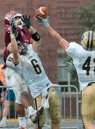 Tribune-Star/Joseph C. Garza<br /> Too many Tigers: Rose-Hulman's Reed Eason can't et a grip on a pass as he is defended by DePauw's Steve Valdiserri (6)  and Jonathan Lambert, right, during the Engineers' game against the Tigers Saturday in Greencastle.