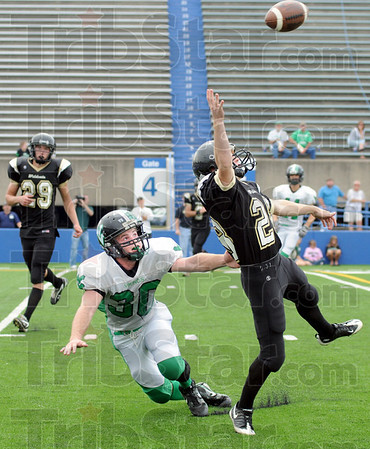 Incomplete: South Vermillion's #28, Justin Manlove leaps for a high pass during game action Saturday at Memorial Stadium. West Vigo's #30, Cody Thornton goes to the ground on the play.