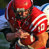 Closer: Marshall runningback Patrick Parsley inches the ball closer to the Lions' firrst touchdown.