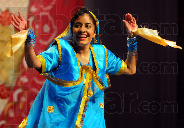 All smiles: Jasmine Singh is all smiles as she dances at the Taste of Indian Saturday evneing.