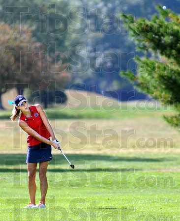 Flight: Rachel Welker watches the flight of her ball during early morning action of girl's sectional play.