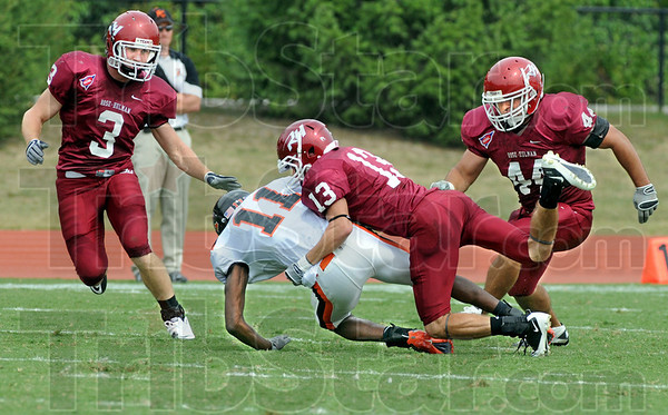 Defended: Rose-Hulman defenders, #3, Austin Davis, #13, Robby Alumbaugh and #44, Andrew Couch contain Kalamazoo's #13, Alex Minch during first half action Saturday.