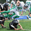 Diving forward: West Vigo's #6, quarterback Lance Garrett dives over defenders enroute to gaining yardage Saturday afternoon.