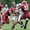 Crunch time: Rose-Hulman defender #46, Scott Eaton puts a big hit on Kalamazoo quarterback #7, Nick Jones with the help of #33, Matt Green during first half action.