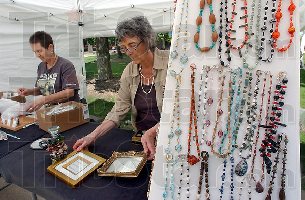 On display: Bev Roddy and Kay Phillips share a tent at the Street Fair. Phillips' work is in bracelets, earrings and necklaces. Her materials include turquoise, a lot of onyx and both red and black coral from, among other places, Mexico, Brazil and El Salvador as we. Roddy's work is in precious metals clay. It is a  recovered material that after shaping and firing is .999% pure silver. Their wares and the items of several other artisans came be seen and purchased near the Hulman Center at the Terre Haute Street Fair.