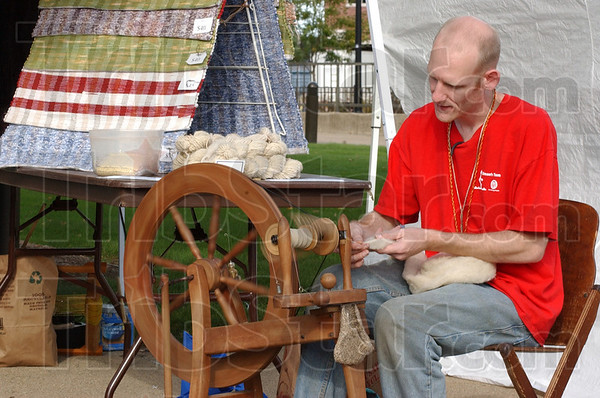 Traditional art: David Hemrich spins wool into yarn at the Terre Haute Street Fair. He purchases his wool locally and cleans, spins and knits it himself.