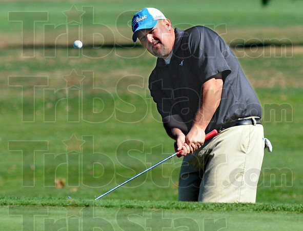 Chip: Rich Schelsky hits a chip shot to the 9th hole at Rea Park during Saturday's City Tournament action. Schelsky parred the hole.