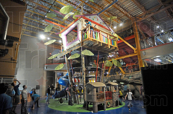 Tree house: Hundreds of children explore at the Terre Haute Children's Museum Saturday afternoon.