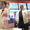 Greetings: League of Women Voters volunteers Barbara Norman and Jacquie Denehie work the voter registration table at the entrance to Baesler's Market Saturday morning.