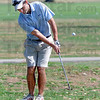 Head down: Matt Shereretz chips to the 18th green during the Men's City Golf Tournament Saturday afternoon.