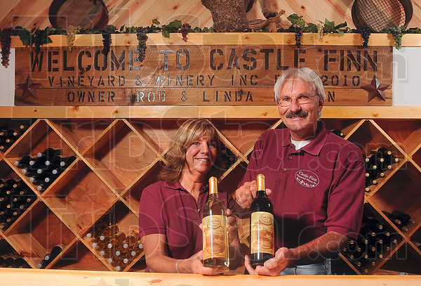 Tribune-Star/Joseph C. Garza<br /> Can we interest you in a bottle?: Linda and Rob Morgan are producing their own varieties of wine that they grow and make at their Castle Finn Winery in Edgar County, Illinois.