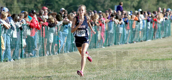 Top three: North's Chanli Mundy heads for the finish line for a third place finnish in the State Preview meet Saturday morning.