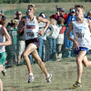 Sandwiched: North's Justin Clapp is sandwiched between two runners in the final 50 yards of Saturday's State Preview meet.