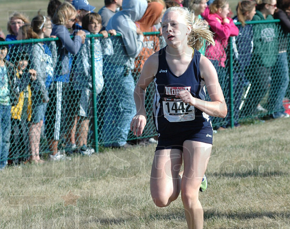 Finish: North's Annie Mullican heads for the finsih line and finishes 43rd in the State Preview meet Satuday morning.