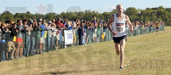 Winner: Terre Haute North's John Mascari heads for the finish line well ahead of the second place runner to win the State Preview meet Saturday morning.