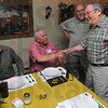 I rememeber: Carl Whitworth, center, shakes hands with his classmate Cel Castagnoli as the meet again. They were members of the Clinton High Schol Class of 1955. With them are Whitworth's son Carl, left, and classmate Rudy Theisz, second from right.