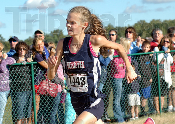 Strong: North's Chanli Mundy finishes strong to take third place in the State Preview meet Saturday morning.