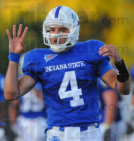 Instructions: Indiana State University quarterback Ronnie Fouch checks his instructions from the bench before a first half play.