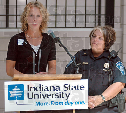Unveiling: Indiana State University representative Amy Janssen-Robinson (L) and ISU police Sgt. Jacquelyn Smith unveil the responsible drinking program during a luncheon Wednesday afternoon.