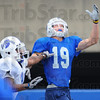 Looking: Sycamore wide receiver Justin Hilton waits for a pass after getting past defensive coverage.
