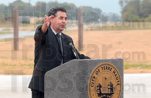 Tribune-Star/Joseph C. Garza<br /> Safety first: American Structurepoint Vice President Chris Murphy talks about the safety precautions taken in building the new Brown Boulevard Thursday during a ribbon cutting ceremony for the new boulevard.