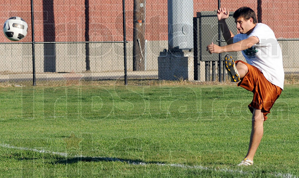Clubber: ISU men's club soccer team player Robert Wirthwein takes a shot on goal during Wednesday's practice.