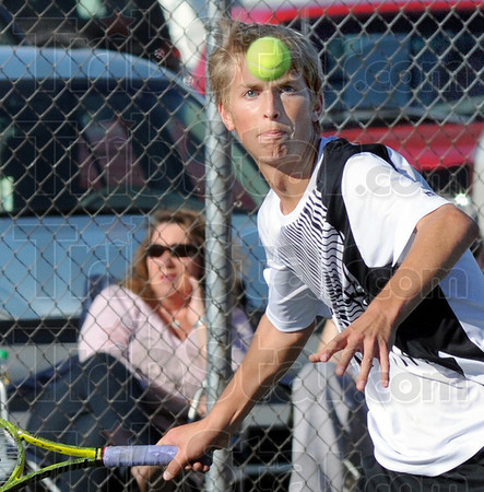 Eye on the prize: South's number one singles player Cameron Crawford watches an incoming ball during match action against James Lisman of Sullivan in sectional play Wednesday evening.