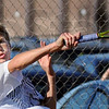 Whack: South's Cameron Crawford hits a forehand during sectional tennis action Wednesday evening.