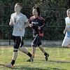 Laps: ISU men's club soccer players run prior to the start of practice Wednesday evening.