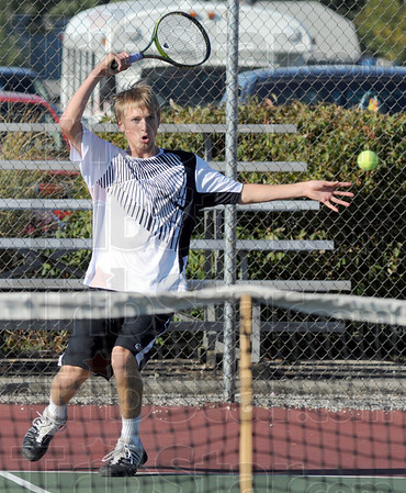 Back at ya: South's Cameron Crawford hits a shot against Sullivan's James Lisman in the number one singles match Wednesday evening.