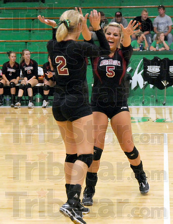 Point: Northview's #2, Lizzie Emmert and #5, Kaylee Clark celebrate a score during match action at West Vigo Monday evening.