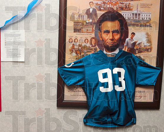 Abraham Freeney?: A framed history of our 16th president is adorned with a No. 93 Dwight Freeney Indianapolis Colts jersey Monday at Ouabache Elementary.