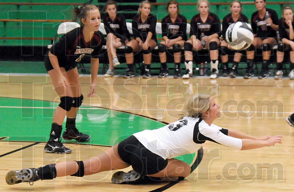 Got it: Northview's #3, Ashlen Buck keeps the ball alive as she dives to the floor during game action Monday evening against West Vigo.