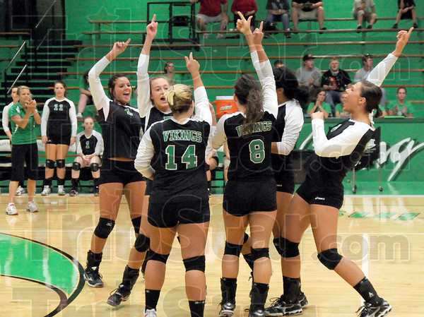 Making a point: Members of the West Vigo volleyball team celebrate a score during match action against Northview Monday evening.