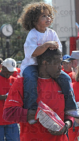 Best seat: Nevaeh Compton rides her dads' shoulders in the Labor Day parade. Rodney Compton is a member of the Plumbers and Fitters Union.