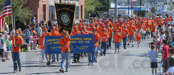 Our day: Members of the Laborers' INternational Union, with family members walk up Wabash Avenue in Mondays' Labor Day parade.
