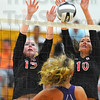 Not here: Braves Morgan Taylor(13) and Madison Steward team up to block a hit by Sullivans' Rhagen Smith.