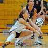 Too hot to handle: Sullivans' Taylor Pierce, playing Libero, tries to dig a serve from Terre Haute South while her teammate Taylor Shake waits.