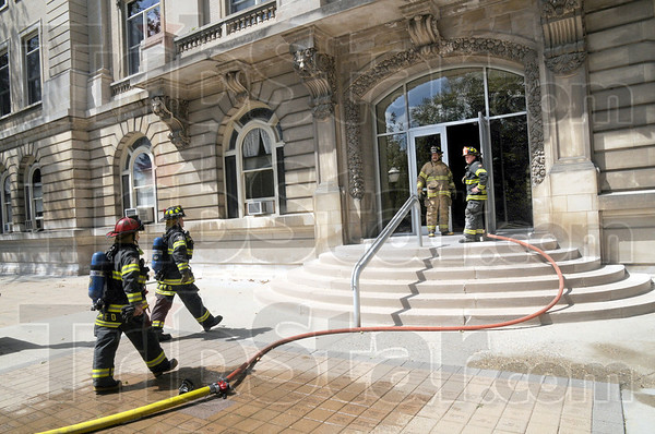 Fire scene: Firefighters enter Guerin Hall on the St. Mary's campus Tuesday afternoon after a fire started in the basement of the building and worked its way to the first floor Tuesday afternoon.