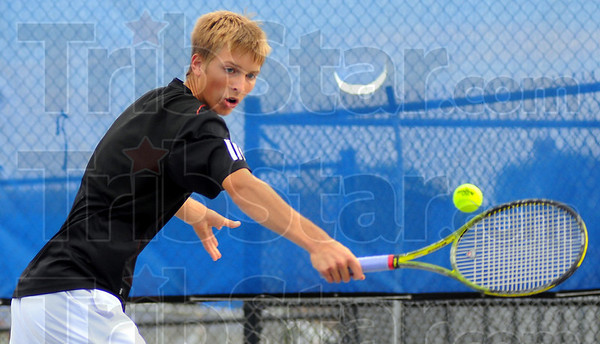 Backhand: Cam Crawford went to three sets with Terre Haute North #1 singles player Nate Sanders.