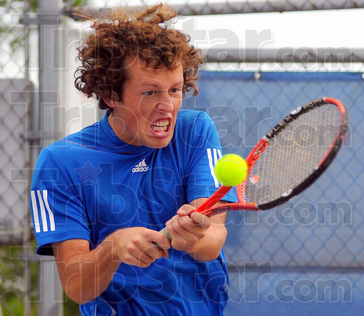 Intense: Nate Sanders returns a shot in his #1 singles match with Cam Crawford.