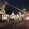 Fire scene: Firefighters work at the scene of a fire Tuesday night in the 300 block of Kent.