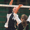 Tribune-Star/Joseph C. Garza<br /> She was set up: Riverton Parke's Sara Dickey spikes the ball over West Vigo's Kaitlyn Cardinal during the Panthers' match against the Vikings Tuesday at West Vigo.