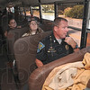 Tribune-Star/Joseph C. Garza<br /> Didn't stop: Indiana State Police Sgt. Chris Wright radios to a fellow trooper in a cruiser the description of a car driven by a motorist who disregarded the stop arm on a school bus on US 40 Tuesday.