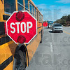Tribune-Star/Joseph C. Garza<br /> This means you: Motorists traveling west on US 40 stop behind the school bus driven by 25-year veteran Patty Love after she displayed the stop sign on her bus to drop off students Tuesday.